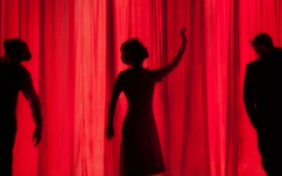 silhouette of people behind curtain dress rehearsal